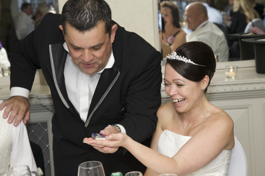wedding magician performs magic for bride