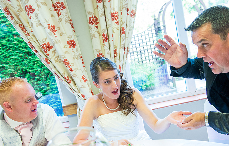 Wedding magician performing for bride and groom